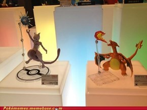 Mewtwo and Charizard figures