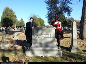 We had our wedding on October 31, 2012. We wanted to do our wedding photos in a cemetery and as we drove by, we found a grave with our last name on it.