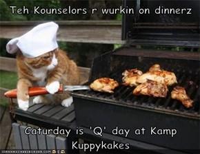 Teh Kounselors r wurkin on dinnerz  Caturday is 'Q' day at Kamp Kuppykakes
