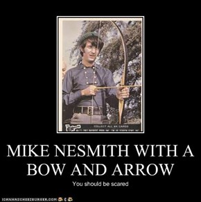 MIKE NESMITH WITH A BOW AND ARROW