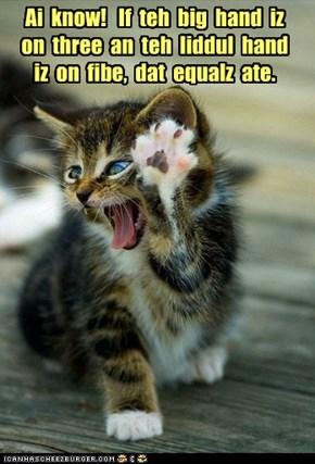 Ai  know!   If  teh  big  hand  iz  on  three  an  teh  liddul  hand  iz  on  fibe,  dat  equalz  ate.