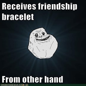 Receives friendship bracelet  From other hand