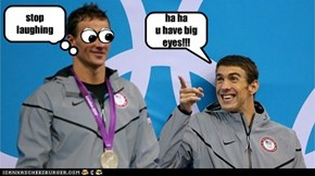 michael phelps laughs at his team mate