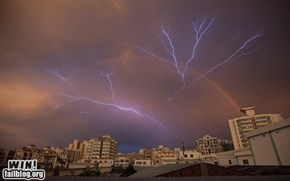 A rainbow appears as lightning strikes after a rainstorm in Haikou, Hainan province, China, on May 13, 2012.