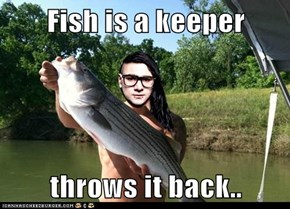 Fish is a keeper  throws it back..