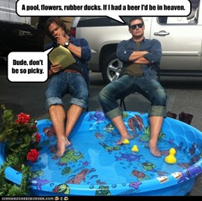 A pool, flowers, rubber ducks. If I had a beer I'd be in heaven.