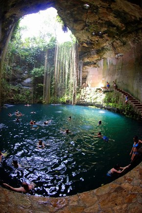 A Quick Dip in the Sagrado Cenote Azul, Chichen Itza, Mexico