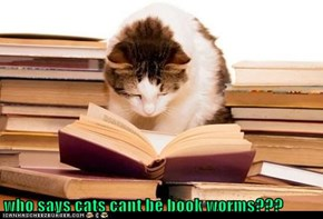 who says cats cant be book worms???