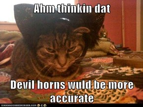 Ahm thinkin dat   Devil horns wuld be more accurate