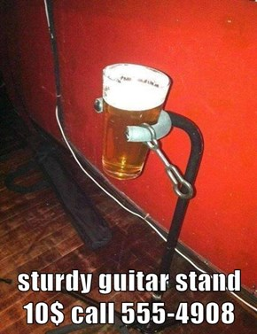 sturdy guitar stand 10$ call 555-4908