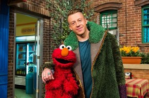 Why is Macklemore Wearing Oscar the Grouch?