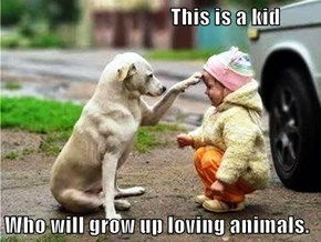 This is a kid   Who will grow up loving animals.