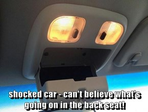 shocked car - can't believe what's going on in the back seat!
