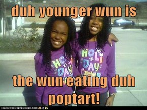 duh younger wun is   the wun eating duh poptart!