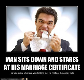 MAN SITS DOWN AND STARES AT HIS MARRIAGE CERTIFICATE