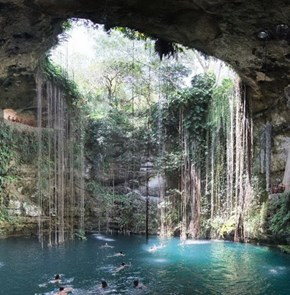 Swimming in the Cenote Ik Kil, Mexico