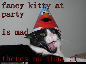fancy kitty at party is mad theres no tuna :(