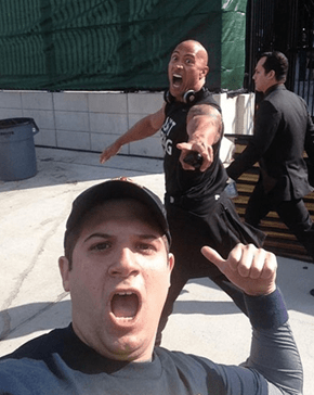 The Rock Likes to Photobomb Too