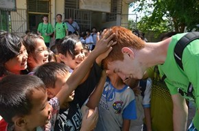 Chinese Children Get Their First Feel of Ginger Hair