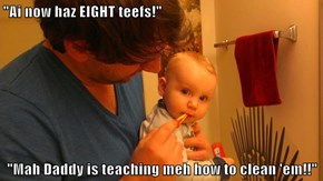 """Ai now haz EIGHT teefs!""  ""Mah Daddy is teaching meh how to clean 'em!!"""