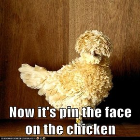 Now it's pin the face on the chicken