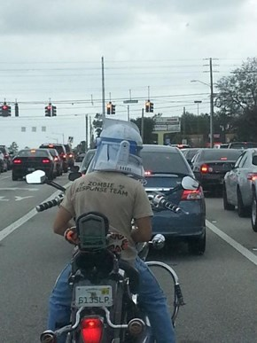 Bike Safety Aside, He Should Probably Wear More Than Just a T-Shirt