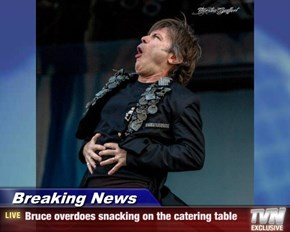 Breaking News - Bruce overdoes snacking on the catering table