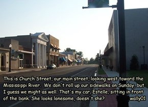 This is Church Street, our main street, looking west toward the Mississippi River.  We don't roll up our sidewalks on Sunday, but I guess we might as well. That's my car, Estelle, sitting in front of the bank. She looks lonesome, doesn't she?