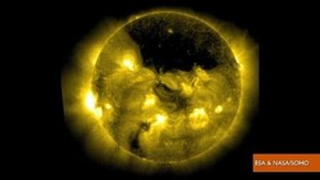 Big Black Spot on The Sun over North Pole