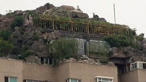 Meanwhile in China of the Day: Man Builds Stone Fortress Atop Skyscraper