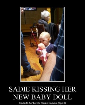 SADIE KISSING HER NEW BABY DOLL