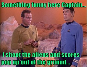 Something funny here Captain...   I shoot the aliens and scores pop up out of the ground...