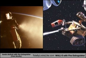 Sandra Bullock with Fire Extinguisher (from Gravity) Totally Looks Like WALL-E with Fire Extinguisher