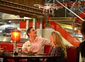 "TGIFridays Put ""Mistletoe Drones"" in Some of Their Restaurants to Encourage Customer on Customer Smooching. Bad Call."