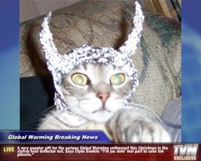 "Global Warming Breaking News - A very popular gift for the serious Global Warming enthusiast this Christmas is the stylish heat deflector hat. Says Clyde Bunkin: ""I'm jus doin' mai part to sabe teh planets."""