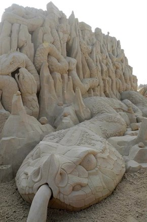 While Everyone's Frozen, Here's a Cool Sand Sculpture to Remind You of Summer!