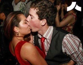 He's Really Impressing Her With His Kissing Skills