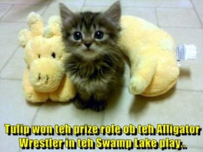 Tulip won teh prize role ob teh Alligator Wrestler in teh Swamp Lake play..