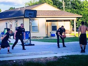 Police Officers Spare a Moment for a Quick Game of Pick-Up