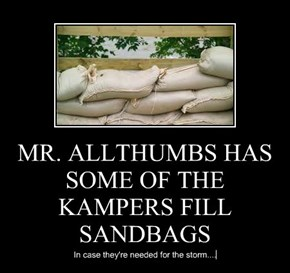 MR. ALLTHUMBS HAS SOME OF THE KAMPERS FILL SANDBAGS