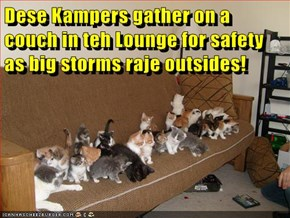 Dese Kampers gather on a couch in teh Lounge for safety as big storms raje outsides!