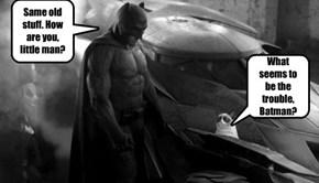 Batman talks to a cat