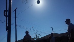 Perfectly Timed Photo of the Day: Basketball Shot Blocks Out the Sun and Makes it Look Like a Solar Eclipse
