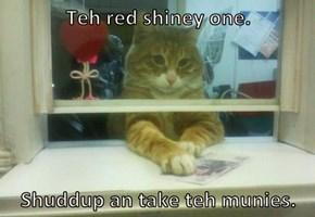 Teh red shiney one.   Shuddup an take teh munies.