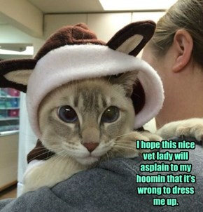I hope this nice vet lady will asplain to my hoomin that it's wrong to dress me up.