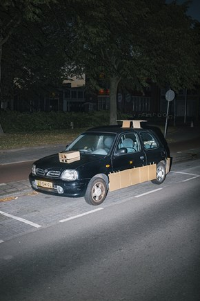 Some Guy Sneaks Around at Night and Pimps People's Rides With Cardboard