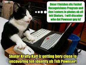 KKPS 2015: Smarty-pants Skolar Krafty Katt wurks on developing hims Fashul Recognishun Program.. Wiff dat Program and teh too drawings ob Teh Pownser by JR an' Stewie, Krafty will be able to pawsitively identify Teh Pownser!