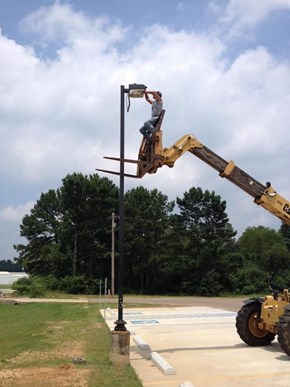 How Much Construction Equipment Does it Take to Change a Light Bulb?