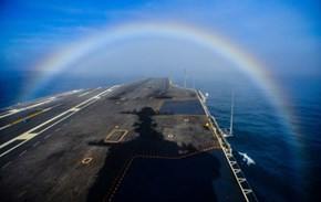 Photo of the Day: Navy Aircraft Carrier Passes Through Rainbow