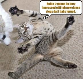 Popular Skolar Millie Tabishsmythe practises som fancy dance moves for teh Balentines Dance.. She iz bery happy to be going wiff Robin Banks..